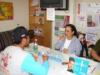 María Rivas, Hispanic Outreach Coordinator for AID Atlanta, administers an AIDS test.
