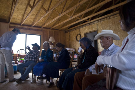 A group of members of the Forgotten People gather in a house at Black Falls,  Ariz., near the uranium-contaminated Box Spring well. Photo by Rachel Wise.