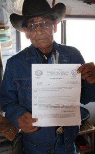 Harry Shorty holds up the letter from his local chapter house denying him government-subsidized weatherization.