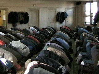 Muslims — many of them Latino — gather for prayer in a local mosque.