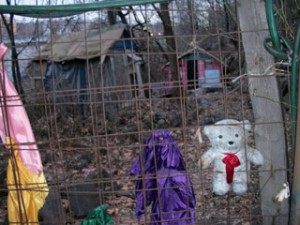 A decorated fence in front of makeshift homes in the Palisades. (photo by Darren Tobia)