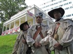 Revolutionary War re-enactors portraying soldiers of the 1st Rhode Island Regiment pose in front of the Hamilton Grange National Memorial in Harlem, Manhattan. From left to right: Thom Wooten, Fred Minus and Leon Brooks of Trenton, N.J. Photo by Louie Lazar