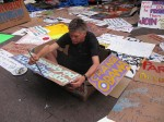 David Everitt-Carlson, 55, paints signs for Occupy Wall Street protests on Columbus Day. His advertising agency in New York went bankrupt after 9/11, leaving him unemployed and homeless. Photo By: Mina Sohail