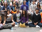 Business magnate Russell Simmons (bottom right) participates in a meditation sit during Occupy Wall Street protests in Lower Manhattan's Zuccotti Park  (Photo by Louie Lazar)
