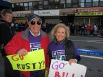 Jack, left, and Barbara Solomon stand along Crescent Street in Queens, waiting for their son Bill, a first time marathoner at age 50. Photo by Chris Palmer