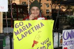 Raquel Mendez, 75, of East Harlem at the NYC Marathon waiting for her friend Maria Lapetina to cross the 19th mile so she can cheer her on.  Photo by Ebony Montenegro