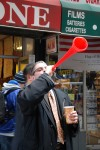 Dave Cutolo used a plastic red horn to inspire fans at the Giants Super Bowl parade to cheer. Photo by Chris Palmer.