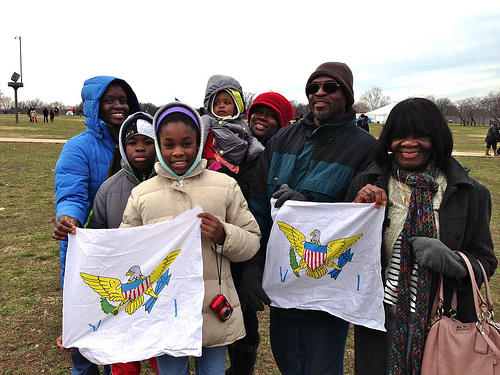 Four generations of the  Lettsome family holds up the flag of the US Virgin Islands at the 2013 Inauguration.Photo by Breana Jones