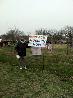 Dr. William Escoffery of Fort Walton Beach, Fla. protests the 2013 Presidential Inauguration. Escoffery, 68, believes people do not realize the problems Obama has created for the country over the past four years. Photo by Timothy Weisberg