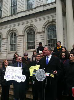 Public Advocate Bill de Blasio speaks at a press conference held Tuesday afternoon at the steps of City Hall. De Blasio, along with parents and other advocates, have called upon Mayor Bloomberg to end the labor dispute. Photo by Timothy Weisberg.