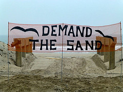 "Cori organized the ""Demand the Sand"" campaign in August 2012 asking state and local officials to tackle beach erosion and address the lack of any beach barriers in place to protect the community. Cori says that even after Sandy swept 1.5 million cubic yards of sand off the beaches, long-term measures to protect the beach have stalled. Photo courtesy of Friends of Rockaway Beach."