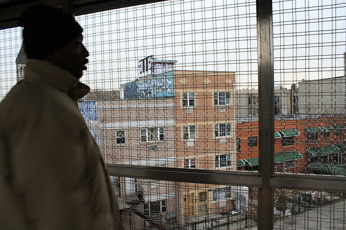 Alex Johnson, who has lived in Bushwick, Brooklyn for 10 years, points out new housing near the Kosciusko train stop. Photo by Gabrielle A. Wright.