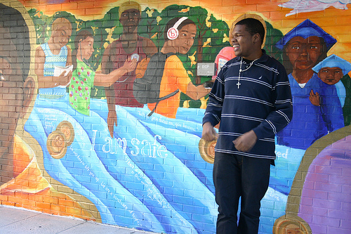 Kelron McJunkin, 20, stands in front of a mural at Covenant House New York. The homeless youth shelter has been his home since August of 2012. Covenant House has 108 beds, and there are more than 21,000 homeless youth living in homeless shelters across the city. Photo by Breana Jones