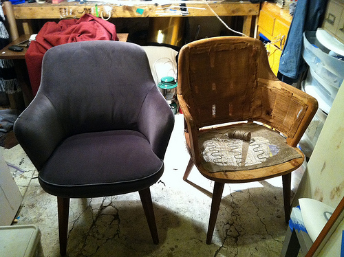 These armchairs are a donated set. The one on the right has yet to be up-cycled, the one on the left has been completely refinished with donated materials. By Alyana Alfaro.