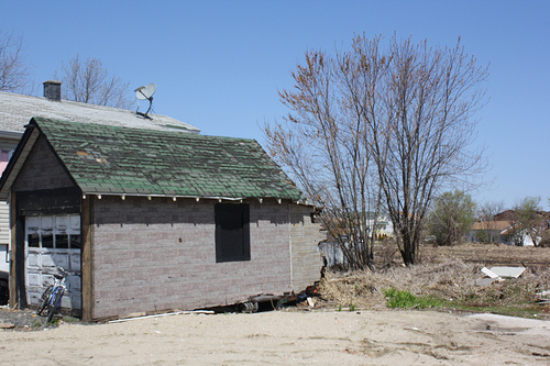 A garage in Oakwood Beach that suffered massive damage from Hurricane Sandy. All of the homes in Oakwood Beach suffered extensive flooding, and many homes are still in need of dire repair six months after the storm. Photo by Timothy Weisberg.
