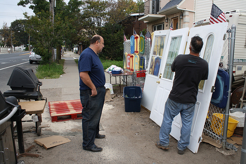 Midland Beach resident Aiman Youssef with Frank, a community member donating a set of doors to the Midland Avenue Neighbourhood Relief Centre. Photo by Nidha Prakash.
