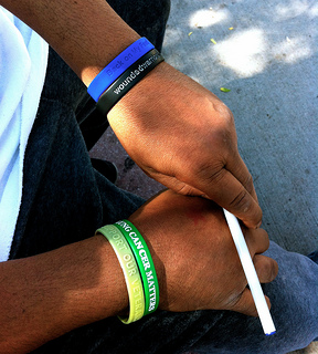 Quinones wears the wristbands of the veteran facilitation programs he has participated in. Photo by Talia Avakian