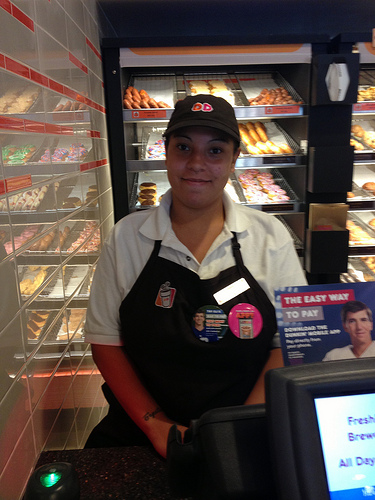 Dunkin Donut worker Crystal Lopez, says she can't afford to buy everything she needs on her minimum wage salary. Photo by Alexandra Palmer.