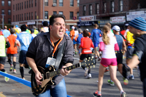 The Third Rail guitarist Matt Daus of Bay Ridge, plays with high intensity at the New York City Marathon. Photo by Talia Avakian