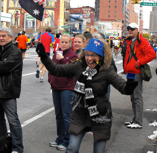 "Jennifer Henry, 46 of Park Slope, cheers in joy after she runs a few steps with a fellow ""Ausie."" Photo by Reuben Jones"