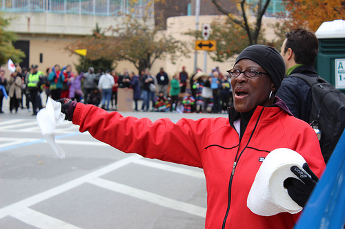 Yvonne Robinson Vaier, handed out paper towels and cheers to runners in West Harlem, Vaier usually runs the marathon herself, but decided to volunteer due to a knee injury. Photo by Alexandra Palmer