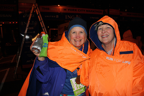 Dale Pierce-Taylor 62, of Atlanta Georgia, and Clare Ronaghn, 51, of Dallas, Texas, pose happily for a photo after finishing the NYC Marathon late Sunday night. By Zoe Lake.