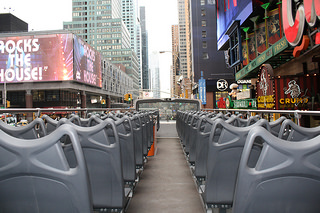 Rows of empty seats on the upper deck of a tour bus in Times Square as temperatures start to drop. Photo by Rajeev Dhir.