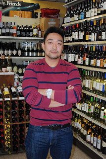 Shon, 34, of Shon 45 Wine and Spirits stands in his shop ready for Super Bowl Business. By Zoe Lake