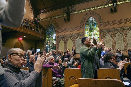 Middle Church members clap to music during Sunday's worship. The Church has over 800 members, who are various races, sexualities and genders. Photo credit: Leticia Miranda.