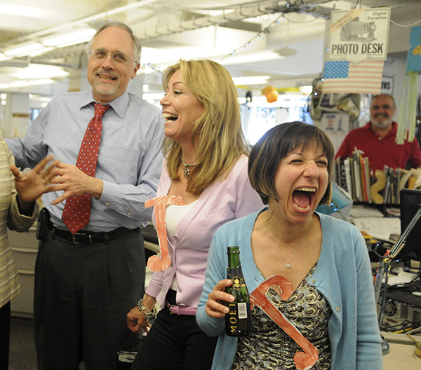 Philadelphia Daily News reporters Wendy Ruderman (far right) and Barbara Laker (second from right) rejoice with city editors Yvette Ousley and Gar Joseph. they won the 2010 Pulitzer Prize for investigative reporting. April 12, 2010 (Photo by Sarah J. Glover)