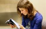 Lisa Kell reads the Book of Mormon . Photo by Julia Shu