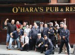 9/11 first responders gather for a group photo at their yearly meeting spot, O'Hara's Pub, NYC. Photo by Thom Friend.