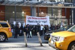 """A Lyme disease silent demonstration in front of the New York Times building in midtown, displayed a large sign that read, """"Lyme disease is a pandemic. Where is the coverage?"""" Photo Credit: Ben Shapiro"""