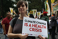 Katie Robbins marching at the People's Climate March on Sunday, September 21 for the Physicians for a National Health Program NY Metro Chapter. Photo credit: Stacey Kilpatrick