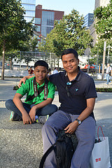 Robby Badruddin, 42, and his son, Zoya, 12, from Indonesia, visited the 9/11 Memorial in their first trip to the U.S. Photo by Virginia Gunawan,