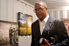 """We Live In Brooklyn, Baby"" curator, Jamel Shabazz at Photoville, a photo exhibit in Brooklyn. Photo credit: Christina Dun"