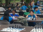 Children play chess at the The 14th Annual Chess-in-the-Park Rapid Open.  Photo by Evgeniya Zolkina