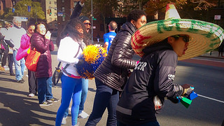A crowd cheers on runners on Sunday morning in Spanish Harlem during the TCS New York City Marathon.