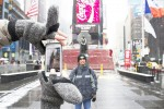 Roel Arriesgado of the Philippines stands for a photo in an empty Times Square. When storm Juno hits later today it will be his first experience with snow. Photo credit: Megan Jamerson