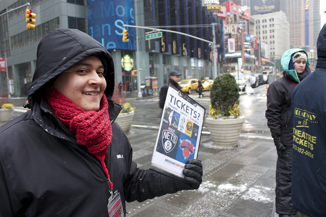 Stephen Velasquez of Washington Heights attempts to sell tickets to tonight's broadway shows in Times Square despite looming blizzard conditions. Photo credit: Megan Jamerson