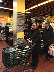Mary Vays ,42,  waits on a long line for the cash register at Fairway Market on second avenue. Photo Credit: Ben Shapiro