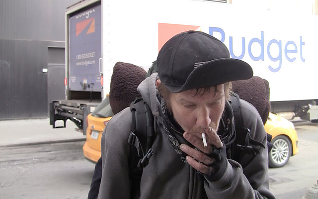 Nicols smokes a cigarette while explaining what he and his homeless friends are going to do to stay warm during this Valentines Day weekends icy weather outside of Starbucks Astor Place.  Photo by Rakeesha Wrigley