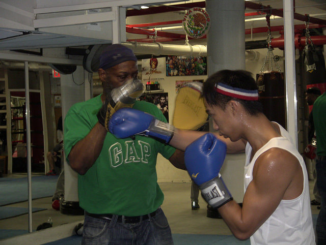 "Trainer Elliot ""The Technician"" Nass working with a young boxer (Photo Credit: Ben Shapiro)"