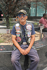 Jose Colon, who honors the 9/11 anniversary every year, wearing a vest he put together to honor and remember the event while downtown on Sept. 11, 2015. Photo by Karis Rogerson