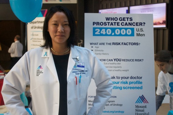 Jillian Capodice, 38, a faculty member at the Department of Urology, stood by her table greeting guests and giving information on prostate cancer prevention. Capodice's goal was to educate men on keeping and maintaining a healthy life. Photo by Ugonma Ubani-Ebere