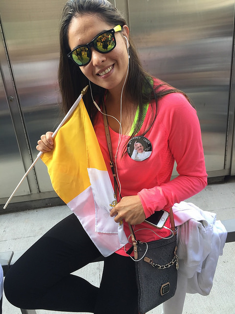 "Lucia Galeano, 28, a New Yorker originally from Paraguay, South America, supports Pope Francis. ""It's like the message now is like love is without limits,"" she said. By Leann Garofolo"