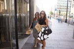 Condé Nast employees Berkeley Gibson and Hayley Sumela return from their lunch break to resume work at One World Trade Center. by Elizabeth Arakelian