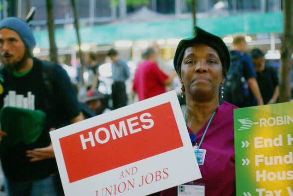 Wensum Pendergrass, a hospital worker, driven to rally in Zuccotti Park by her desire for less expensive rent. She is a mother and her daughter lives with her. She is certain that if she loses her job she will become homeless. Photo by Diego Lynch