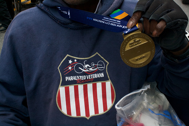 James Johnson's finisher medal along with his sweatshirt sporting the Paralyzed Veterans emblem. Photo by Leann Garofolo