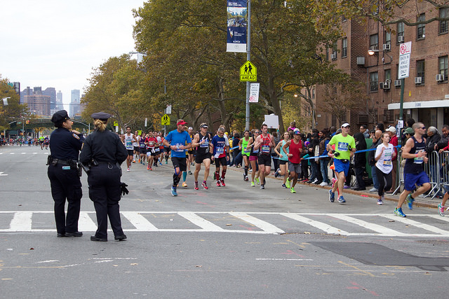 The intersection of East 138 Street and Alexander Avenue in the South Bronx was busy with participants in the 2015 New York City Marathon who ran through on their way towards Central Park and the finish line. Photo by Elizabeth Arakelian